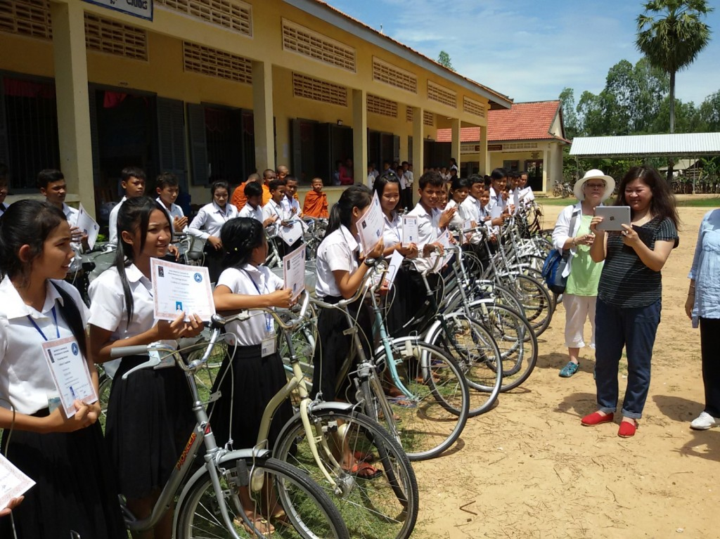 Graduating seniors receive a new bike and a certificate qualifying their technological education.